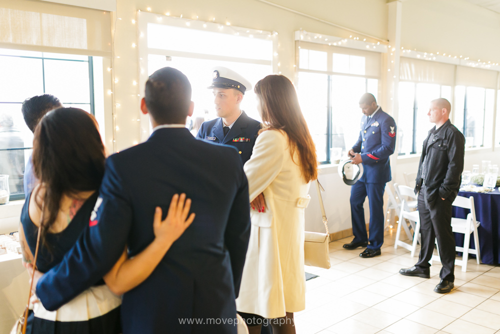 A groom-to-be and member of the United States Coast Guard waits for his bride to be ready on their wedding day at the Mavericks Event Center in Half Moon Bay, CA.