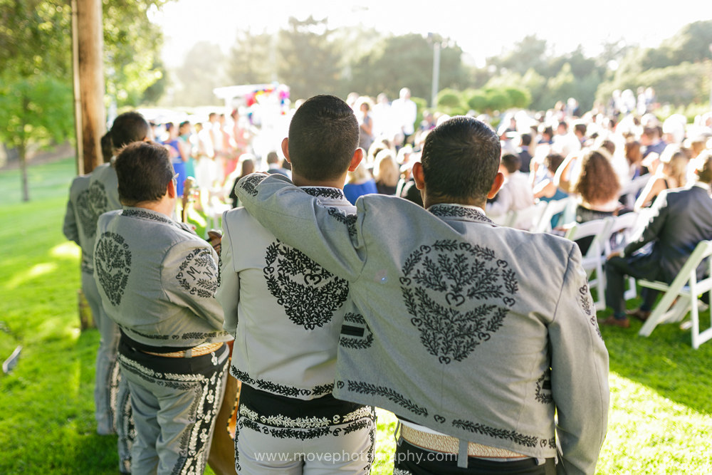 Mariachi band members embrace during a wedding ceremony at Sequoyah Country Club in Oakland, CA.